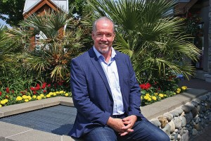 Rick Stiebel/News Gazette staff July 15, 2015 -- B.C. New Democratic Party leader and the MLA for Juan de Fuca, John Horgan, relaxes amid a tropical backdrop along Goldstream Avenue in Langford, the most populous part of his riding.